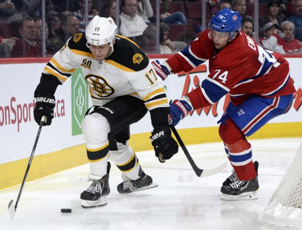 Boston Bruins forward Milan Lucic (17) skates with the puck as Montreal Canadiens defenseman Alexei Emelin (74) chases during the third period at the Bell Centre in Montreal Wednesday night.