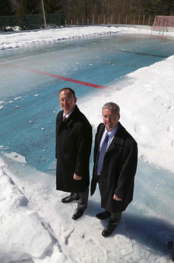 Tom Marjerison, left, and John Veilleux of Casco Bay Hockey Association at the site of a defunct outdoor ice rink on Hat Trick Drive in Falmouth. The association plans to build a new pavilion-style rink, if the Town Council grants the nonprofit group a lease for the land.