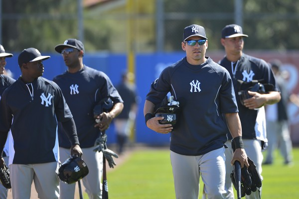 New York Yankees center fielder Jacoby Ellsbury (22) and his teammates walk on to the field prior to the game against the Toronto Blue Jays at Florida Auto Exchange Park.