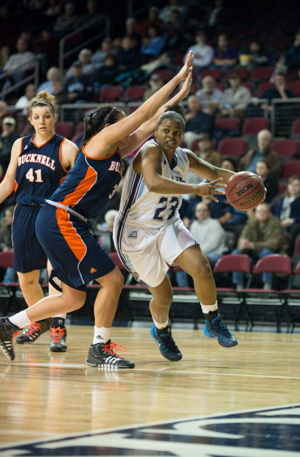 The University of Maine's Ashleigh Roberts drives baseline against Bucknell in a first-round game in the Women's Basketball Invitational Wednesday night at the Cross Insurance Center in Bangor. Maine defeated Bucknell 77-47.