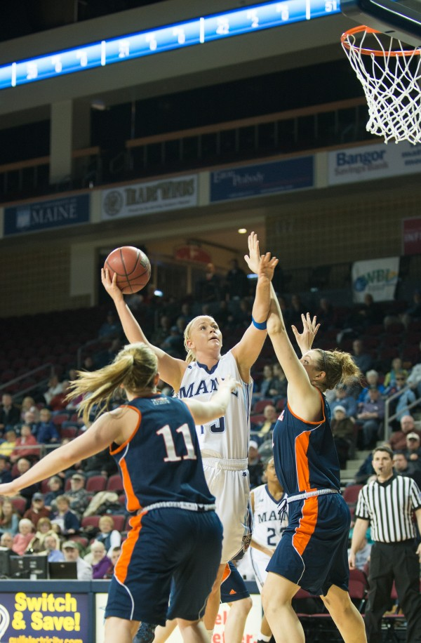The University of Maine's Mikaela Gustafsson shoots over Bucknell's Megan McGurk during a Women's Basketball Invitational first-round game Wednesday night at the Cross Insurance Center in Bangor. Maine won 77-47.