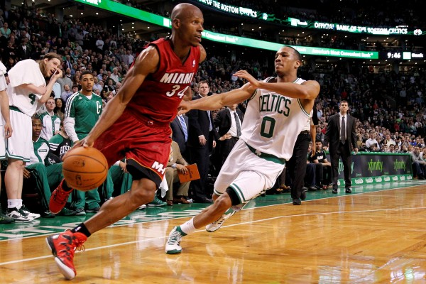 Miami Heat shooting guard Ray Allen (34) dribbles the ball as Boston Celtics guard Avery Bradley defends during the fourth quarter at TD Garden in Boston Wednesday night. The Celtics won 101-96.