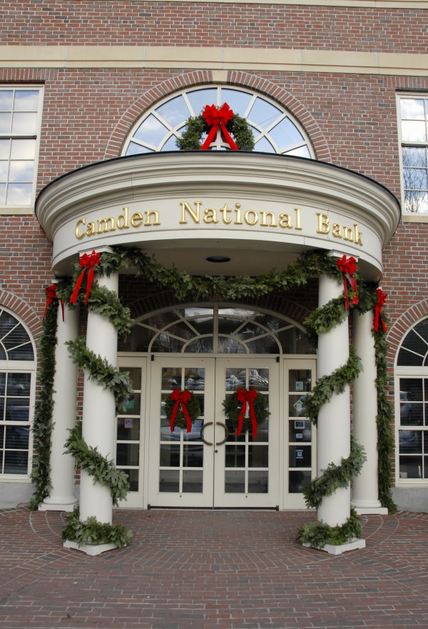 Christmas garland winds around the four front entrance columns as a Christmas hangs above the main entrance at Camden National Bank's headquarters in Camden in this 2011 file photo.