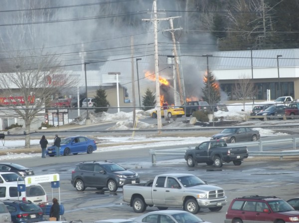 Flames erupt from a small storage building behind the McDonald's restaurant in Machias on U.S. 1 Wednesday afternoon. The fire was brought under control in about 30 minutes.