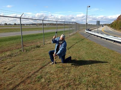 Jay Sawyer of Warren drives a stake into the ground where his piece &quotA Spirit of Its Own&quot will be installed at the Portland International Jetport this spring.