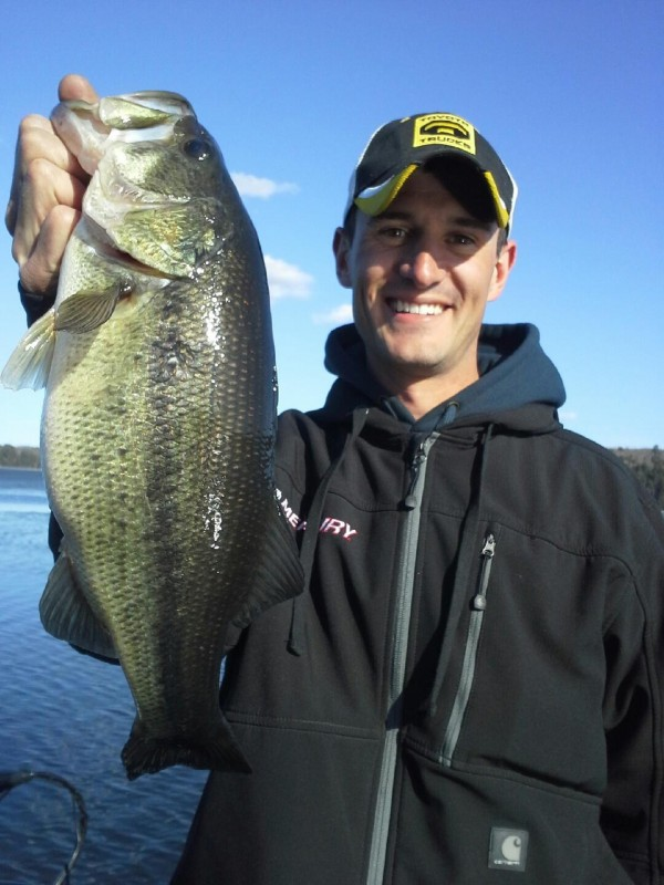 Jonathan Carter shows off a four-pound bass that he caught on Annabassacook Lake in September 2013.