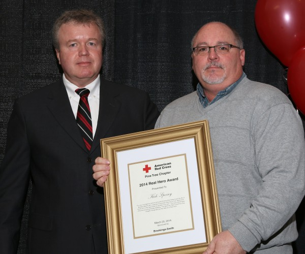 Kirk Sperrey (right) after receiving a Real Hero Award from the Pine Tree Chapter of the American Red Cross.