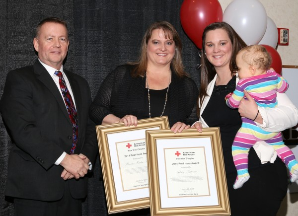 Bonnie Martin (center) and Ashley Patterson (right) after receiving Real Hero Awards from the American Red Cross Pine Tree Chapter for their efforts to save the lives of two pedestrians struck by a van.