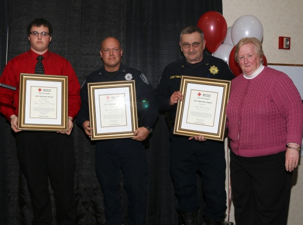 Junior Firefighter Ryan-Michael Havey (from left), Pittsfield police Officer Jeffrey Vanadestine and Chief Steven Emery after receiving Real Hero Awards from the American Red Cross.
