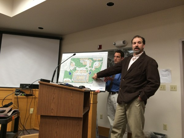 New York-based Park 7 Group, who has proposed a 270-unit student housing complex on Washburn Drive, has hired WBRC Architects and Engineers of Bangor to design the project. WBRC landscape architect Paul Brody, right, points to two of the four vernal pools on the subdivision site plan during a public hearing held March 19, 2014, while WBRC engineer Paul Monyok holds a map of the plan.