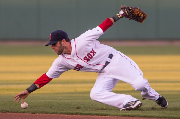 Boston Red Sox second baseman Dustin Pedroia reaches for the ball in the first inning against the New York Yankees at JetBlue Park in Fort Myers, Fla., Thursday night.