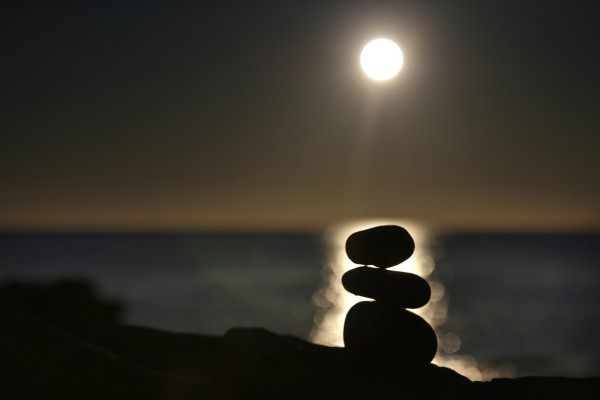 Balancing rocks are silhouetted at sunrise overlooking the Atlantic Ocean in Acadia National Park in Maine.
