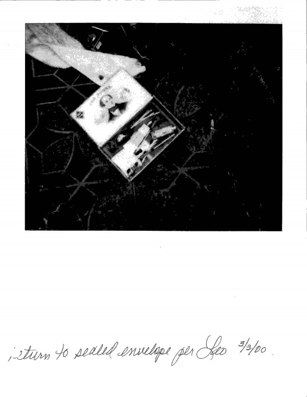 A police handout photo released on March 20, 2014 by Seattle Police Department shows articles left at grunge rock musician Kurt Cobain's 1994 death scene.