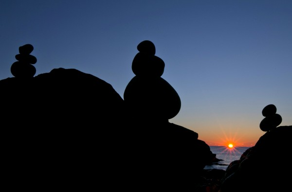 Balancing rocks appear to watch the sunrise over the Atlantic Ocean earlier this month at Acadia National Park in Maine.