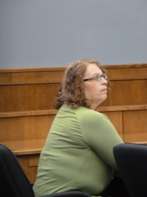 Wendy Farley, 48, of Brownville waits Thursday for her trial to begin at the Piscataquis County Courthouse in Dover-Foxcroft. She is accused of trying to hire a hitman to kill her husband in September 2012.