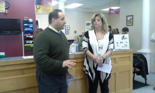 Bangor Attorney Joseph Baldacci explains a $395,000 bequest to Bangor Humane Society Executive Director Suzan Bell at a press conference Friday, March 21, 2014, at BHS. Gillespie had volunteered at the shelter for many years.