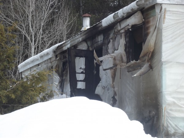 A mobile home that was heavily damaged by fire in Danforth on Friday morning.