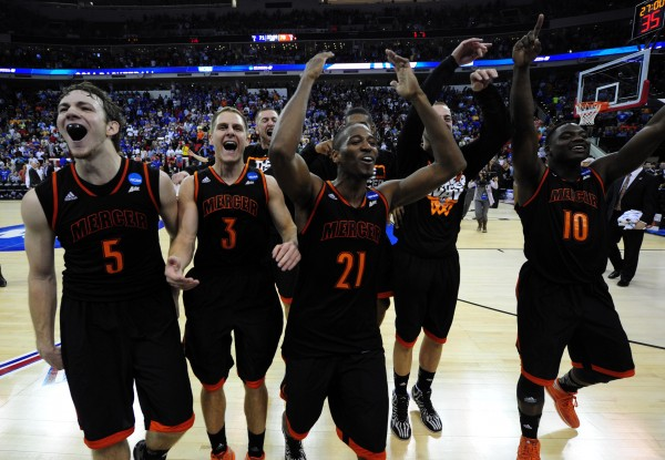 The Mercer Bears celebrates beating the Duke Blue Devils in a men's college basketball game during the second round of the 2014 NCAA Tournament at PNC Arena.