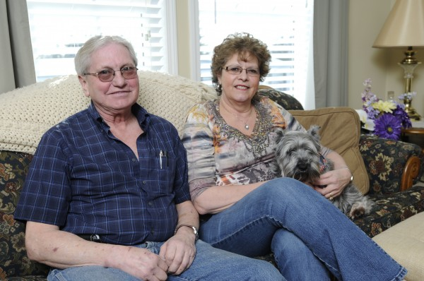 Armand and Lorraine Pelletier of Bangor sit with their dog Cody in their Bangor home. Both are still haunted by the remains of a newborn that was brought lifeless to their doorstep by their Husky Paca a little over 28 years ago in Frenchville.