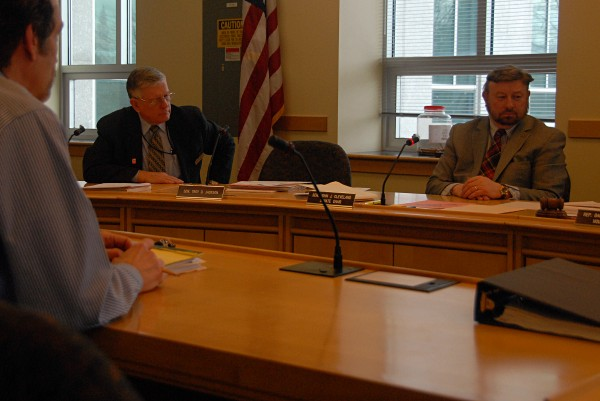 State Sen. John Cleveland (far right) listened to attorney John Clark (left) outline fixes to a bill, LD 1792, during a committee hearing on Friday.