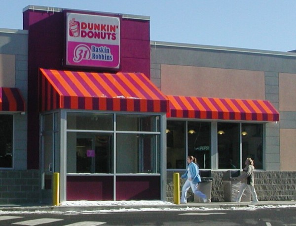 "Customers make their way into Dunkin' Donuts at the corner of Route 1A and Forest Avenue in Ellsworth. Plans are in the works to open a third Dunkin' Donuts at the intersection of Kingsland Crossing and Route 3. In addition, Dairy Queen is looking to build a new ""Grill & Chill"" restaurant on High Street."