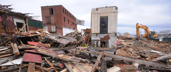 The walk-in safe that was inside the former Old Town Canoe Co. building remains standing as demolition continued Friday at the  site in downtown Old Town.