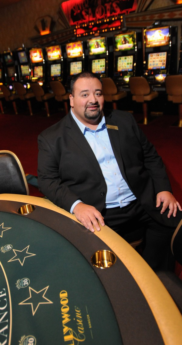 Jose Flores, the new general manager of Hollywood Casino in Bangor, sits at a table game on Thursday.