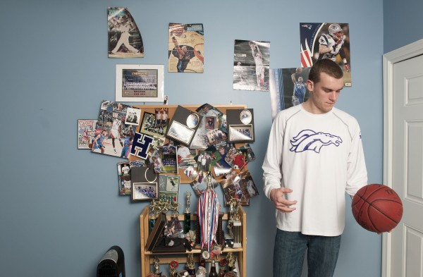 Zach Gilpin plays with a basketball in his room at his family's home in Hampden on Sunday.