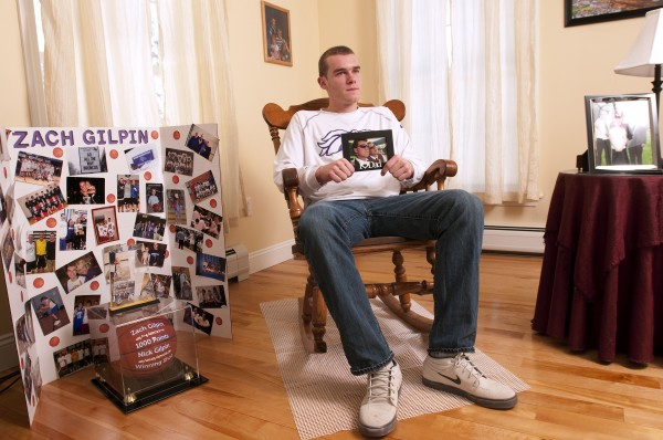 Zach Gilpin's family home in Hampden is filled with both family pictures, such as the one he is  holding of him and his father, and mementos of Zach's high school basketball career.