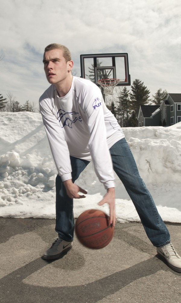 Zach Gilpin practices some of his basketball moves outside on Sunday.