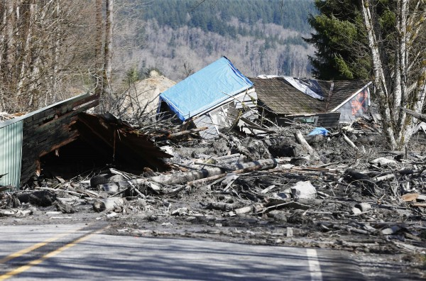 A landslide and structural debris blocks Highway 530 near Oso, Washington March 23, 2014. Eighteen people remain unaccounted for in a landslide that killed three and injured at least eight more in northwestern Washington state, officials said Sunday.