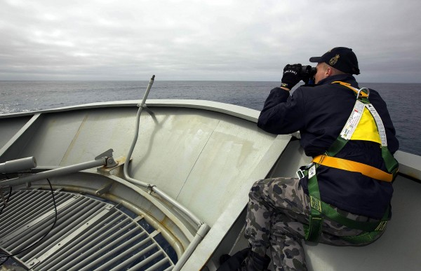 Able Seaman Kurt Jackson keeps watch on the forecastle of the Australian Navy ship, the HMAS Success, in a search area for missing Malaysian Airlines Flight MH370 on Monday.