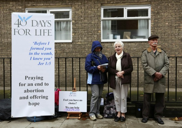 Campaigners from the 40 Days for Life anti-abortion campaign hold a prayer vigil opposite a Marie Stopes family planning clinic in London September 26, 2012.
