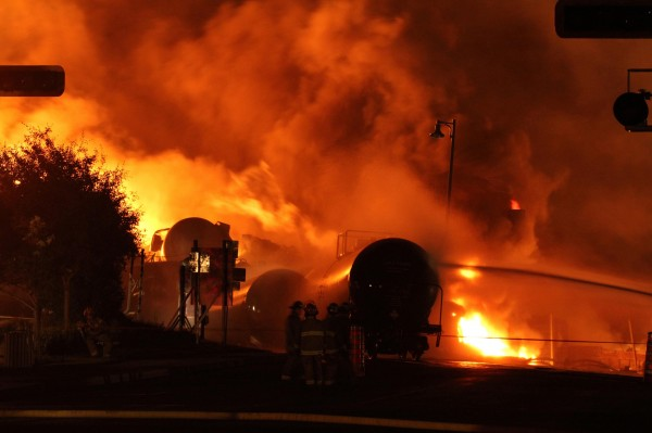 First responders fight burning train cars after a train derailment and explosion in Lac-Megantic, Quebec, in July 2013.