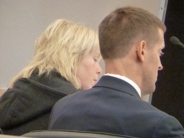Jaime Meservey (left) of Palmyra waits with her attorney, Walter McKee of Augusta, to plead no contest to a theft charge Monday at the Penobscot Judicial Center in Bangor.