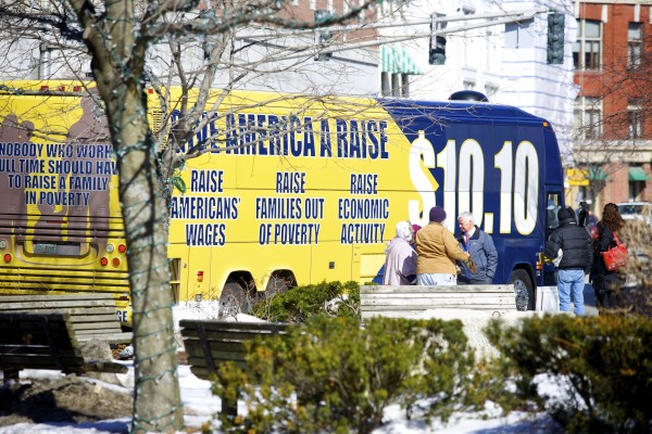 Congressman Mike Michaud greets people who attended the &quotGive America a Raise&quot bus tour that stopped in Bangor's West Market Square Monday morning during a campaign attempt by officials to raise the minimum wage to $10.10 throughout the state.