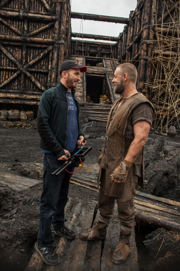 Director Darren Aronofsk (left), and Russell Crowe talk on the set of &quotNoah.&quot