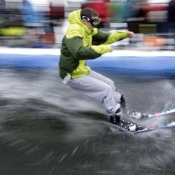 A competitor skims across a man-made pond during the 30th annual Slush Cup on Saturday, at Shawnee Peak in Bridgton.
