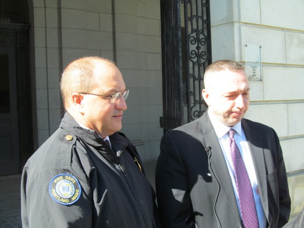 Portland Fire Chief Jerome LaMoria (left) and Police Chief Michael Sauschuck address reporters Monday afternoon outside City Hall. The public safety officials announced the arrest of Robert Johnson, 19, of Portland in connection with a fire behind the Portland Museum of Art on Sunday night.