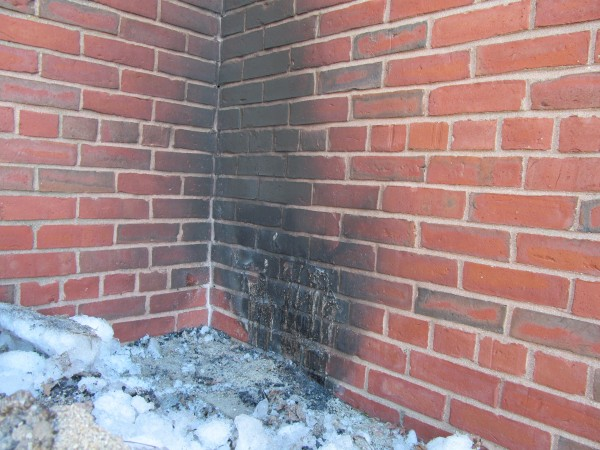 Charring can be seen on the bricks in a secluded rear corner of the Portland Museum of Art building. Police arrested Robert Johnson, 19, of Portland in connection with a fire set at the location Sunday night.