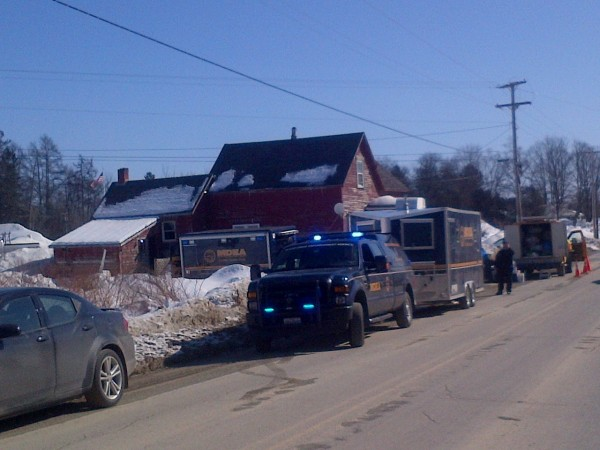 Police and drug agents investigate a meth lab in Hodgdon on Tuesday.
