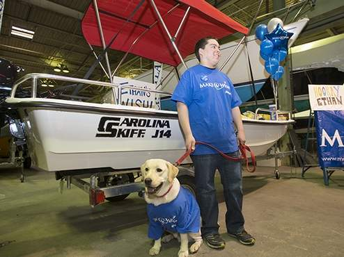 Ethan Houle, 17, is a Kennebunk student in need of a kidney transplant. He received his wish of a boat, a Carolina Skiff J1450, that was revealed on Monday.