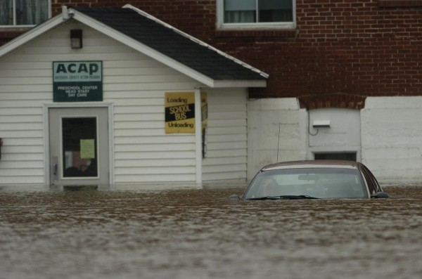 A submerged car remained in a parking lot of B&M Apartments and a Head Start program office off East Main Street in Fort Kent as the Fish River flooded into downtown Fort Kent on April 30, 2008.