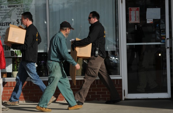 In this November 2011 file photo, federal agents leave the Twin Super Buffet in Brewer with boxes of evidence.