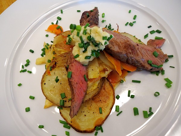 Ribeye steak with roasted vegetables and horseradish is a typical main course at the Stonewall Kitchen Cooking School.