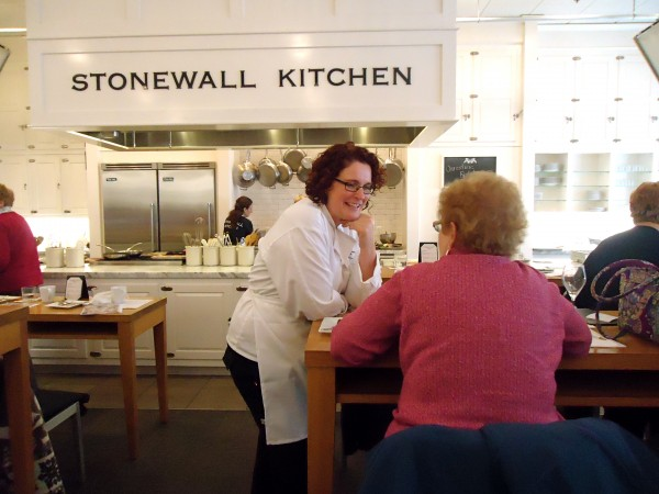 Class dismissed. Brunswick chef Christine Rudalevige talks to students at Stonewall Kitchen Cooking School after her one-pan supper class last week.