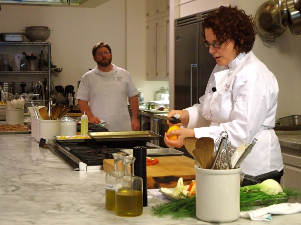 Brunswick chef Christine Rudalevige prepares one-pan suppers at Stonewall Kitchen Cooking School last week as chef and instructor Scott Jones looks on.