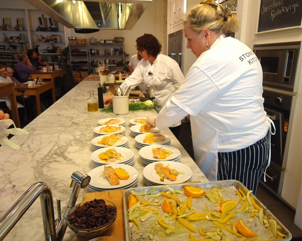 Salmon with fennel, bell peppers and olives is demoed and served at Stonewall Kitchen Cooking School last week.