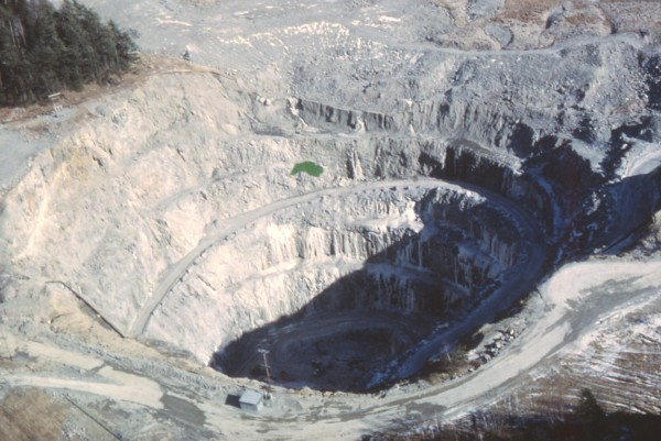 In this file photo made in the 1970s and provided by the Maine Geological Survey, the Callahan Mining Corp. open pit in Brooksville, Maine, is seen while it was still active.