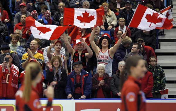 Canadian fans cheer while Canada's second Alison Kreviazuk wave to them prior to the gold medal game against Switzerland at the World Women's Curling Championships in Saint John, New Brunswick, on Sunday.